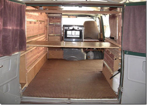 pic of finished shelves from the back of he old van